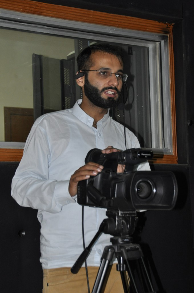 A student is handling Camera during TV recording.