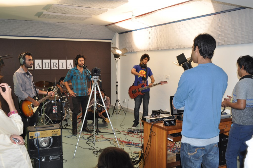 students are recording a music show in BU studio.